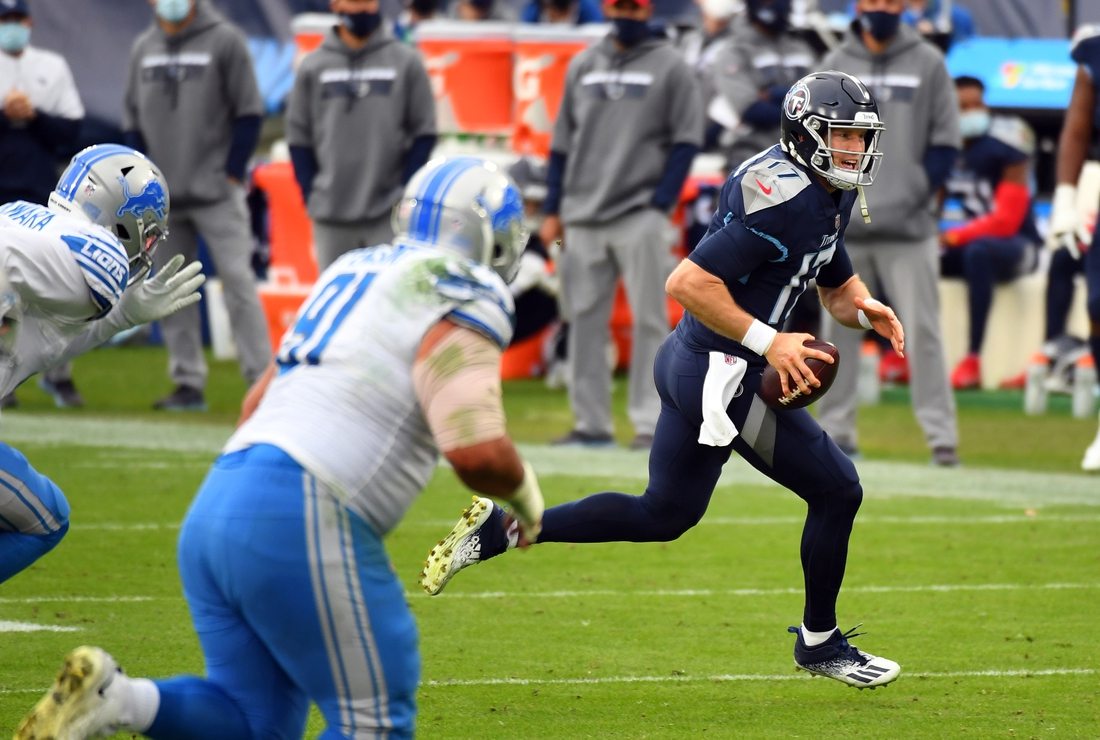 Dec 20, 2020; Nashville, Tennessee, USA; Tennessee Titans quarterback Ryan Tannehill (17) runs with the ball for a touchdown during the first half against the Detroit Lions at Nissan Stadium. Mandatory Credit: Christopher Hanewinckel-USA TODAY Sports