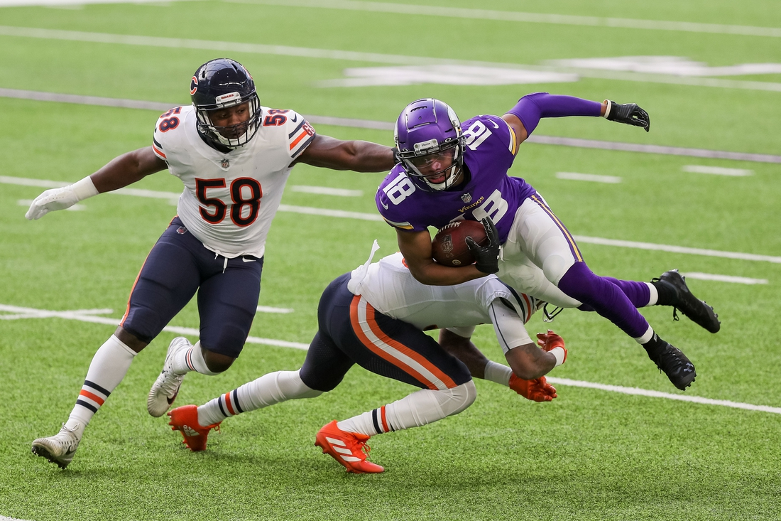 Dec 20, 2020; Minneapolis, Minnesota, USA; Minnesota Vikings wide receiver Justin Jefferson (18) is tackled in the first quarter against the Chicago Bears at U.S. Bank Stadium. Mandatory Credit: Brad Rempel-USA TODAY Sports
