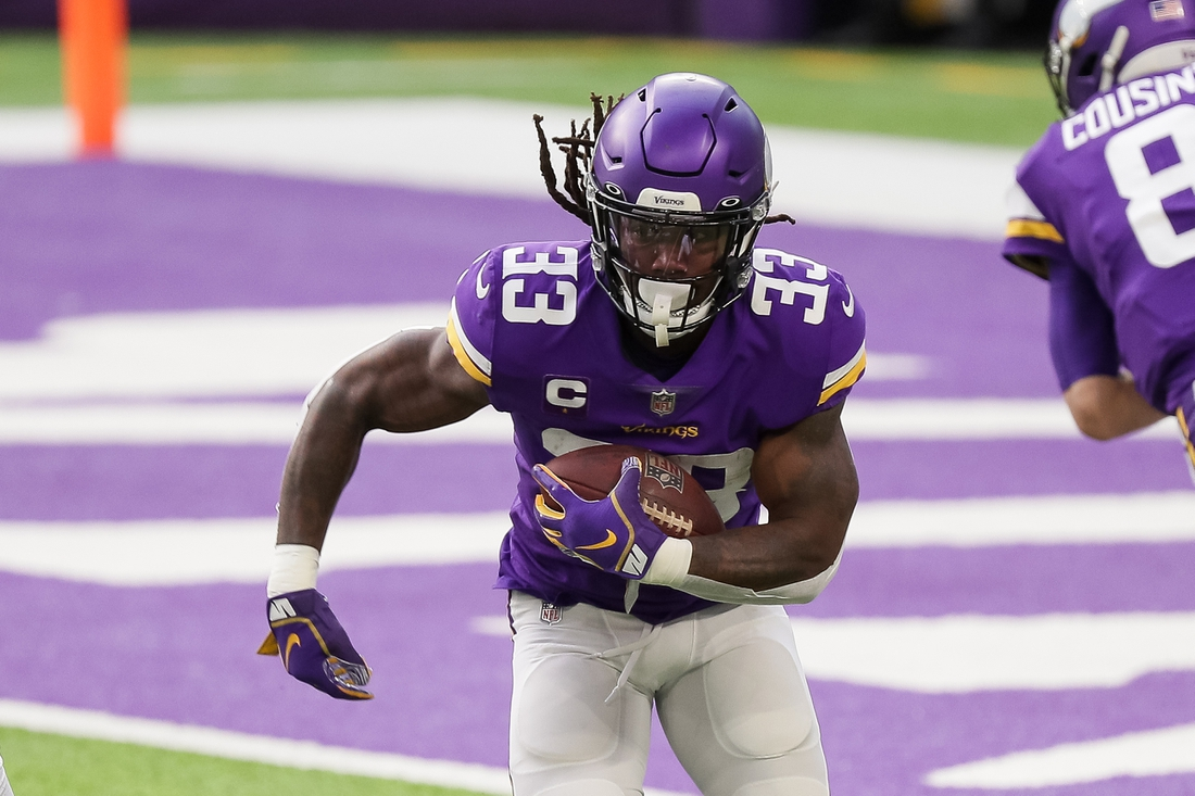 Dec 20, 2020; Minneapolis, Minnesota, USA; Minnesota Vikings running back Dalvin Cook (33) runs the ball in the first quarter against the Chicago Bears at U.S. Bank Stadium. Mandatory Credit: Brad Rempel-USA TODAY Sports