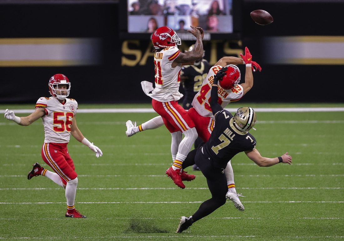 Dec 20, 2020; New Orleans, Louisiana, USA;  Kansas City Chiefs safety Daniel Sorensen (49) and cornerback Bashaud Breeland (21) break up a pass to New Orleans Saints receiver Taysom Hill (7) during the first quarter at the Mercedes-Benz Superdome. Mandatory Credit: Derick E. Hingle-USA TODAY Sports