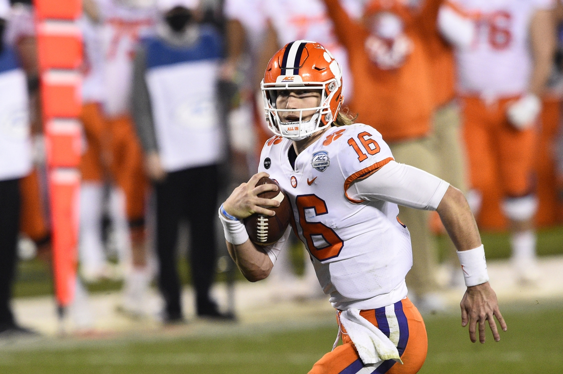 Dec 19, 2020; Charlotte, NC, USA; Clemson Tigers quarterback Trevor Lawrence (16) runs for a touchdown in the third quarter at Bank of America Stadium. Mandatory Credit: Bob Donnan-USA TODAY Sports