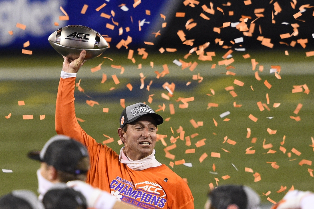 Dec 19, 2020; Charlotte, NC, USA; Clemson Tigers head coach Dabo Swinney celebrates with the trophy after winning the ACC Football Championship at Bank of America Stadium. Mandatory Credit: Bob Donnan-USA TODAY Sports