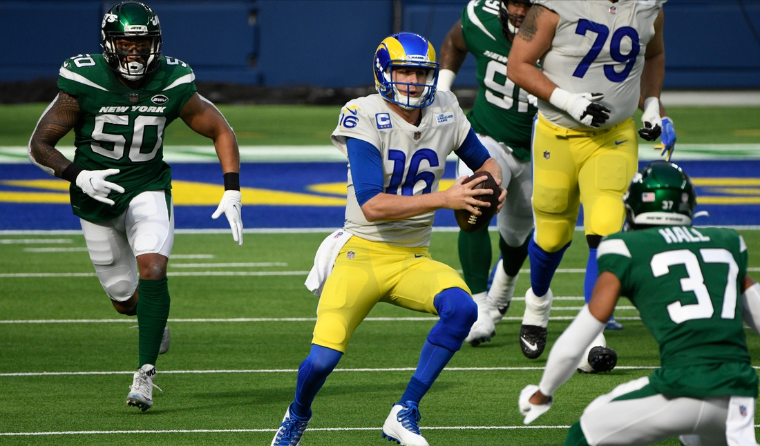 Dec 18, 2020; Los Angeles, California, USA; Los Angeles Rams quarterback Jared Goff (16) is flushed out of the pocket during the first quarter against the New York Jets at SoFi Stadium. Mandatory Credit: Robert Hanashiro-USA TODAY Sports