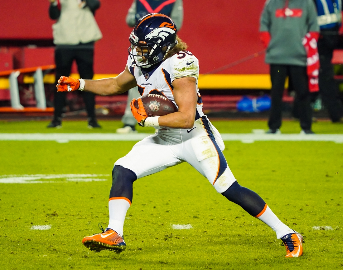 Dec 6, 2020; Kansas City, Missouri, USA; Denver Broncos running back Phillip Lindsay (30) runs against the Kansas City Chiefs during the first half at Arrowhead Stadium. Mandatory Credit: Jay Biggerstaff-USA TODAY Sports