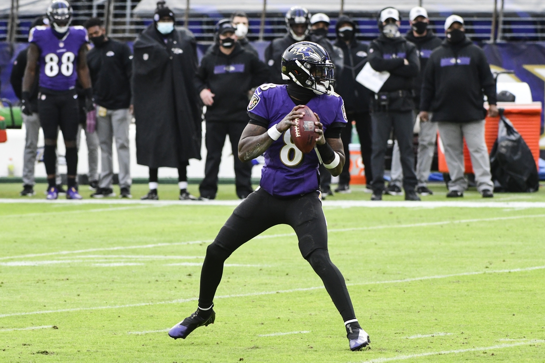 Dec 20, 2020; Baltimore, Maryland, USA;  Baltimore Ravens quarterback Lamar Jackson (8) drops back in the pocket to pass during the game against the Jacksonville Jaguars at M&T Bank Stadium. Mandatory Credit: Tommy Gilligan-USA TODAY Sports