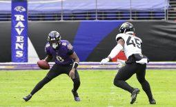 Dec 20, 2020; Baltimore, Maryland, USA;  Baltimore Ravens quarterback Lamar Jackson (8) runs as Jacksonville Jaguars linebacker K'Lavon Chaisson (45) defends during the game at M&T Bank Stadium. Mandatory Credit: Tommy Gilligan-USA TODAY Sports