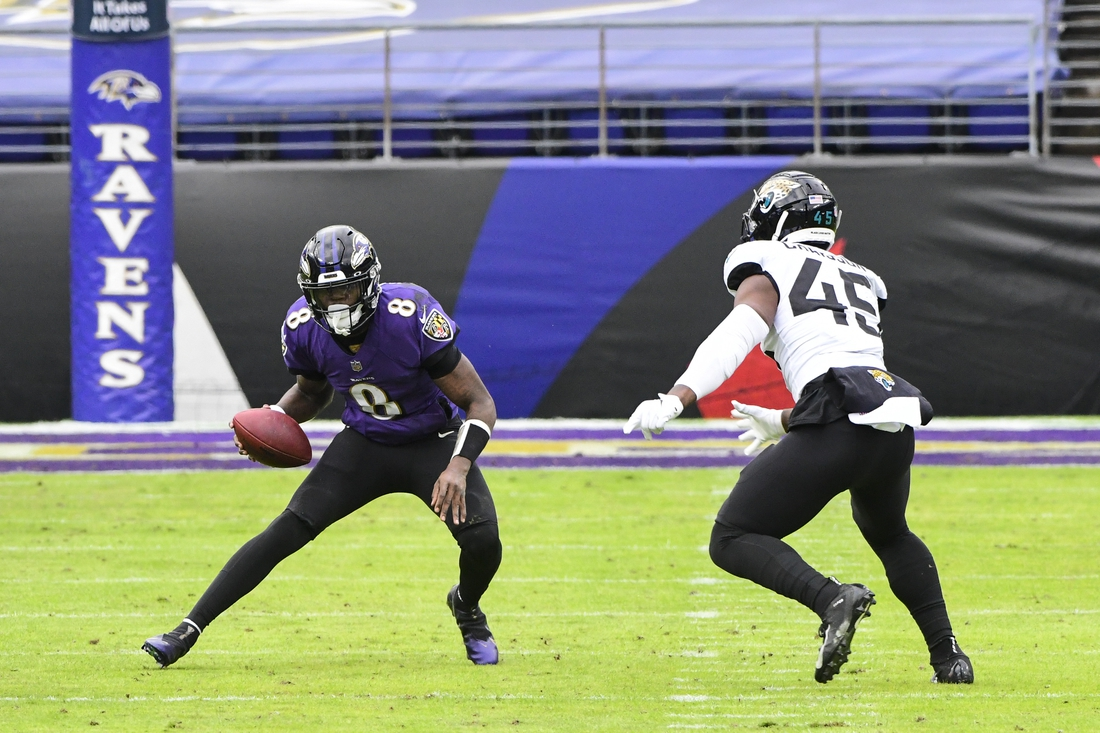 Dec 20, 2020; Baltimore, Maryland, USA;  Baltimore Ravens quarterback Lamar Jackson (8) runs as Jacksonville Jaguars linebacker K'Lavon Chaisson (45) defends during the game at M&T Bank Stadium. Mandatory Credit: Tommy Gilligan-USA TODAY Sports