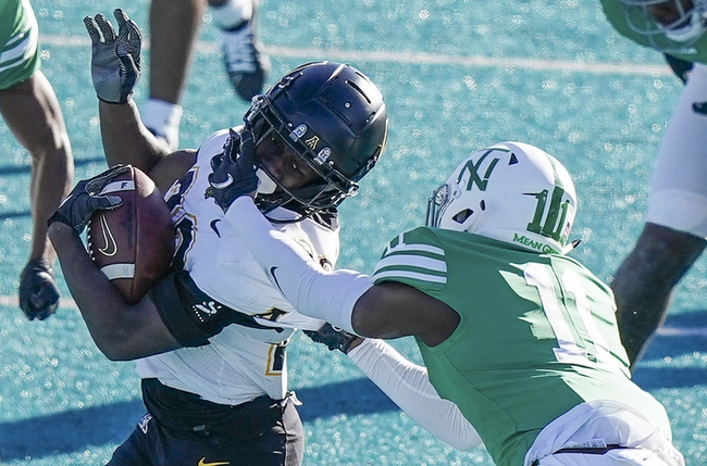 Dec 21, 2020; Conway, SC, USA; Appalachian State Mountaineers running back Nate Noel (20) is grabbed by the face mask by North Texas Mean Green defensive back Cam Johnson (11) at Brooks Stadium. Mandatory Credit: David Yeazell-USA TODAY Sports