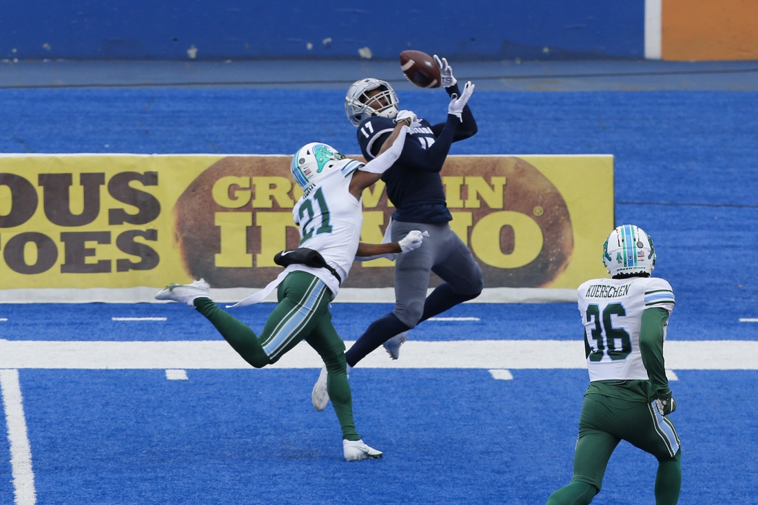 Dec 22, 2020; Boise, Idaho, USA; Nevada Wolf Pack wide receiver Justin Lockhart (17) catches a touchdown pass during the first half of the Famous Idaho Potato Bowl versus the Tulane Green Wave  at Albertsons Stadium. Mandatory Credit: Brian Losness-USA TODAY Sports