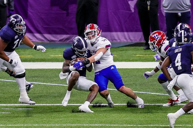 Dec 23, 2020; New Orleans, LA, USA;  Georgia Southern Eagles quarterback Shai Werts (1) runs through the tackle of Louisiana Tech Bulldogs linebacker Tyler Grubbs (52) to score a touchdown during the New Orleans Bowl at Mercedes-Benz Superdome. Mandatory Credit: Stephen Lew-USA TODAY Sports