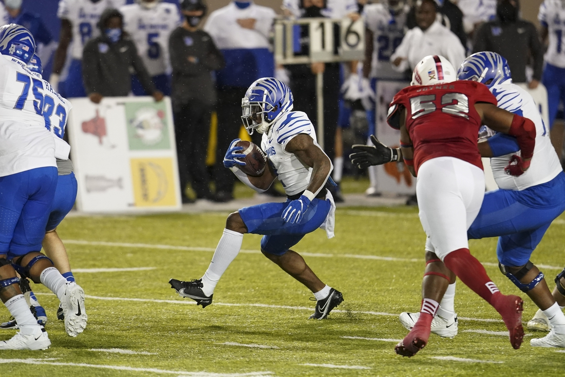 Dec 23, 2020; Montgomery, AL, USA; Memphis Tigers wide receiver Calvin Austin III (4) carries the ball against Florida Atlantic Owls during the first half at Cramton Bowl Stadium. Mandatory Credit: Marvin Gentry-USA TODAY Sports