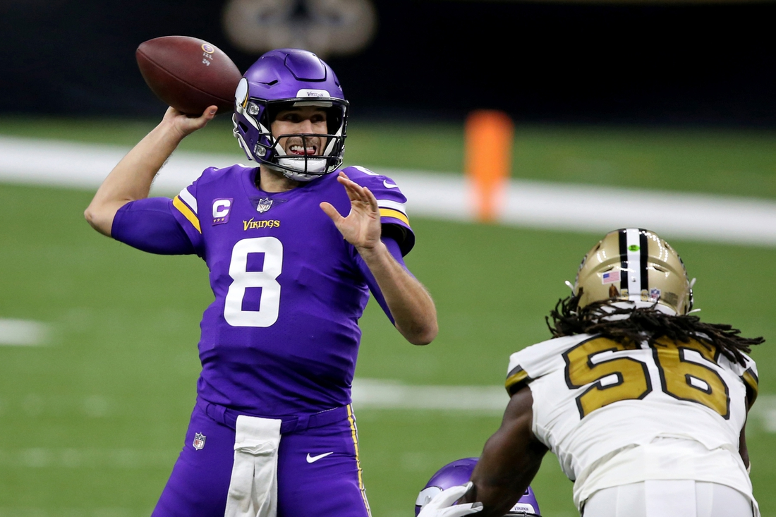 Dec 25, 2020; New Orleans, Louisiana, USA; Minnesota Vikings quarterback Kirk Cousins (8) looks to throw in the first quarter against the New Orleans Saints at the Mercedes-Benz Superdome. Mandatory Credit: Chuck Cook-USA TODAY Sports