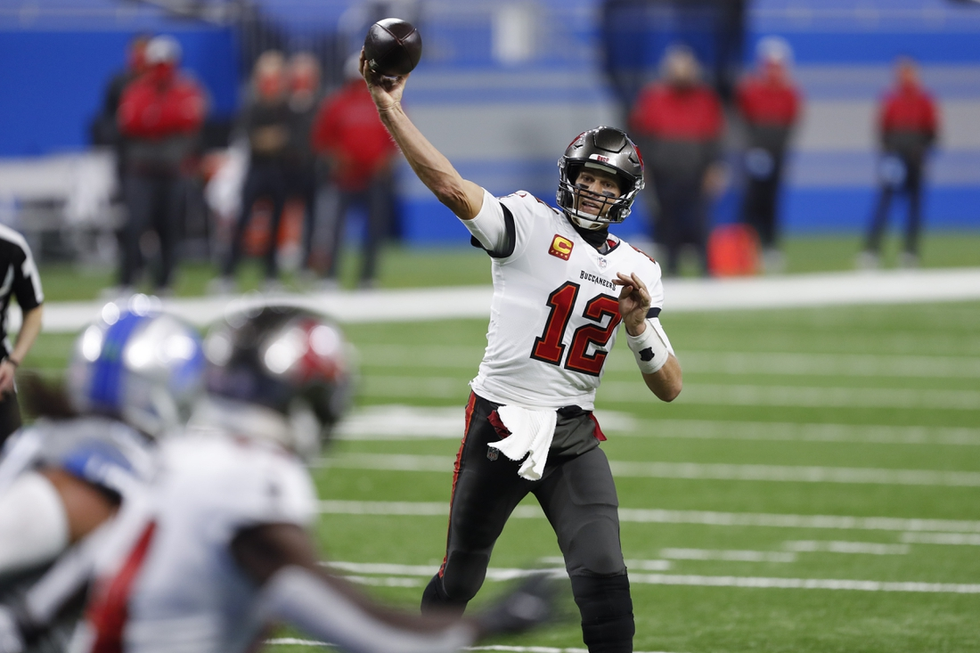 Dec 26, 2020; Detroit, Michigan, USA; Tampa Bay Buccaneers quarterback Tom Brady (12) throws a touchdown pass to wide receiver Chris Godwin (14) against the Detroit Lions during the second quarter at Ford Field. Mandatory Credit: Raj Mehta-USA TODAY Sports