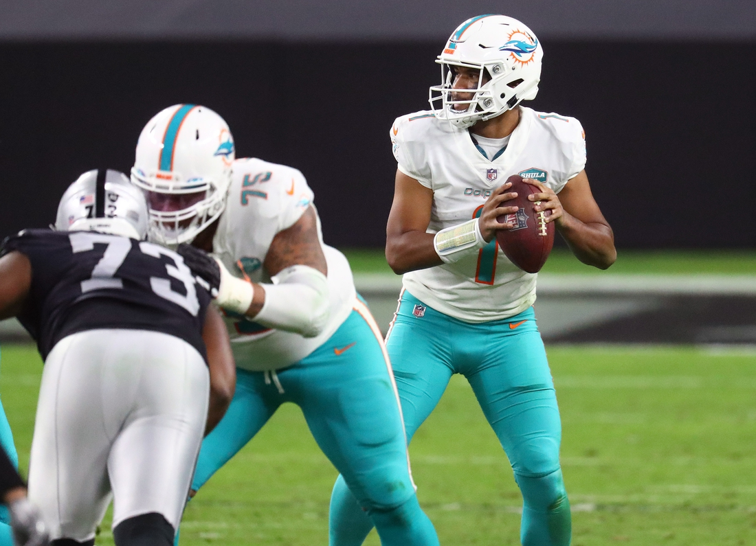 Dec 26, 2020; Paradise, Nevada, USA; Miami Dolphins quarterback Tua Tagovailoa (1) drops back to pass against the Las Vegas Raiders during the first half at Allegiant Stadium. Mandatory Credit: Mark J. Rebilas-USA TODAY Sports