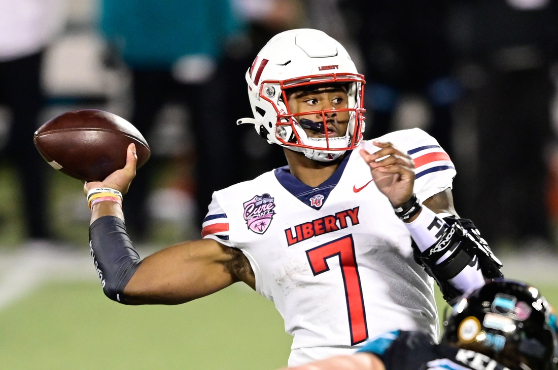 Dec 26, 2020; Orlando, FL, USA; Liberty Flames quarterback Malik Willis (7) looks to pass the ball during the second quarter against the Coastal Carolina Chanticleers during the Cure Bowl at Camping World Stadium. Mandatory Credit: Douglas DeFelice-USA TODAY Sports