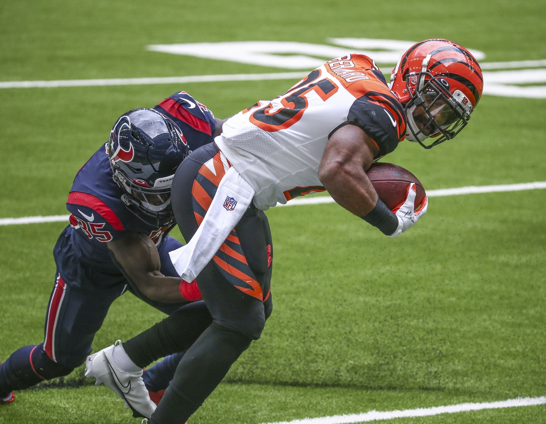 Dec 27, 2020; Houston, Texas, USA; Cincinnati Bengals running back Giovani Bernard (25) runs the ball against Houston Texans cornerback Keion Crossen (35) during the first quarter at NRG Stadium. Mandatory Credit: Troy Taormina-USA TODAY Sports