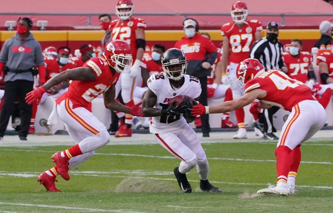 Dec 27, 2020; Kansas City, MO, USA;  Atlanta Falcons wide receiver Calvin Ridley (18) catches a pass between Kansas City Chiefs cornerback Bashaud Breeland (21) and free safety Daniel Sorensen (49) in the first half of a NFL game at Arrowhead Stadium. Mandatory Credit: Denny Medley-USA TODAY Sports