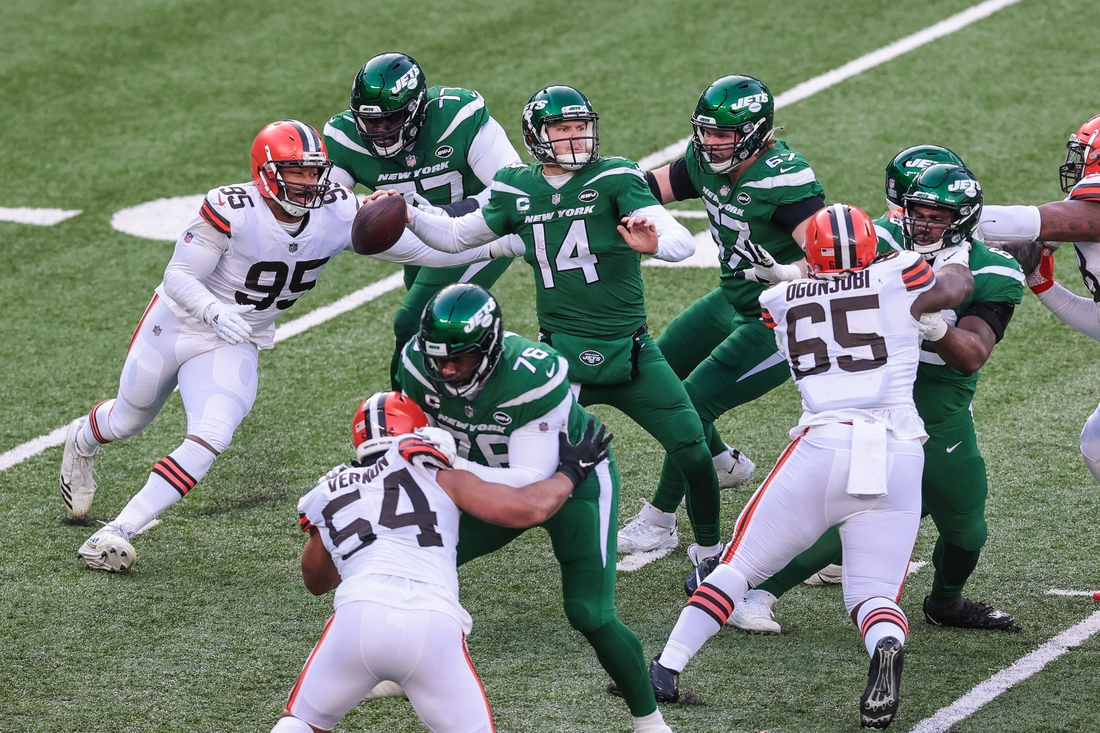 Dec 27, 2020; East Rutherford, New Jersey, USA; Cleveland Browns defensive end Myles Garrett (95) knocks the arm of New York Jets quarterback Sam Darnold (14) while throwing the ball during the half half at MetLife Stadium. Mandatory Credit: Vincent Carchietta-USA TODAY Sports