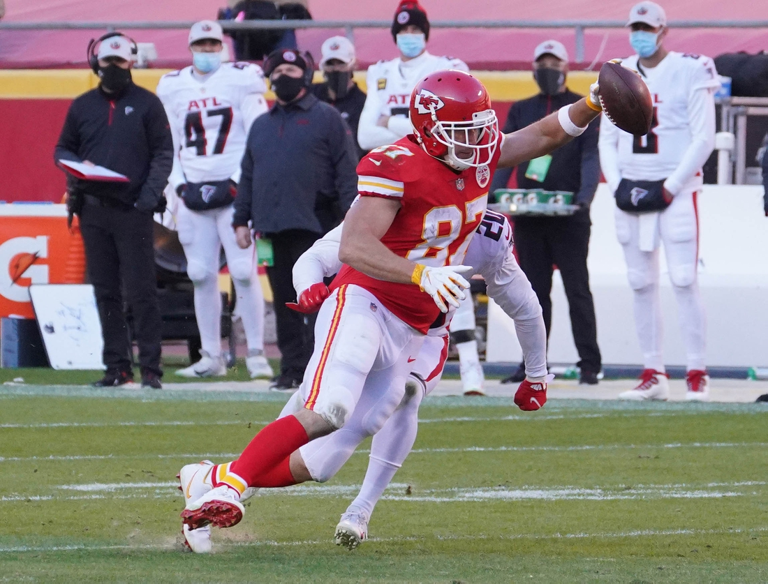 Dec 27, 2020; Kansas City, MO, USA; Kansas City Chiefs tight end Travis Kelce (87) catches a pass against Atlanta Falcons defensive back Kendall Sheffield (20) in the fourth quarter of a NFL game at Arrowhead Stadium. Mandatory Credit: Denny Medley-USA TODAY Sports