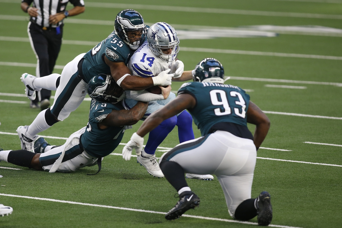 Dec 27, 2020; Arlington, Texas, USA; Dallas Cowboys quarterback Andy Dalton (14) is sacked by Philadelphia Eagles offensive tackle Andre Dillard (77) and defensive end Brandon Graham (55) in the first quarter at AT&T Stadium. Mandatory Credit: Tim Heitman-USA TODAY Sports