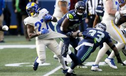 Dec 27, 2020; Seattle, Washington, USA; Los Angeles Rams running back Darrell Henderson (27) rushes against Seattle Seahawks strong safety Jamal Adams (33) during the first quarter at Lumen Field. Mandatory Credit: Joe Nicholson-USA TODAY Sports