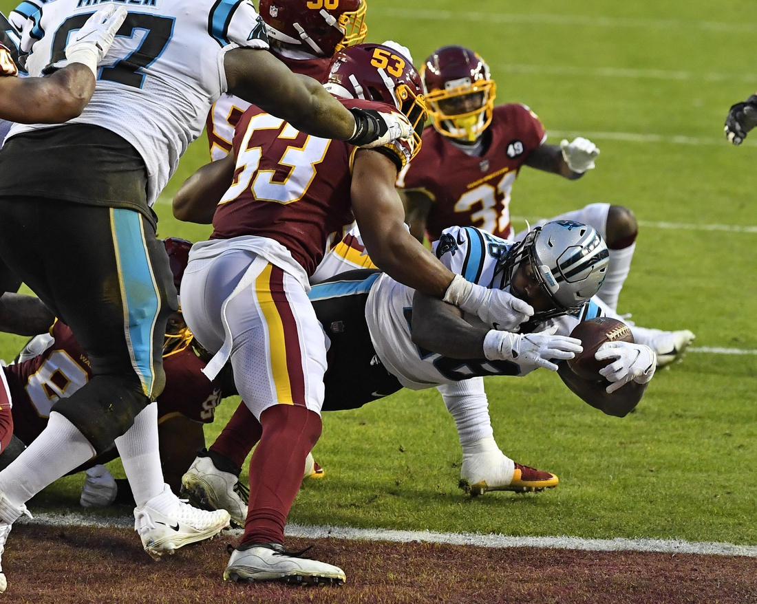 Dec 27, 2020; Landover, Maryland, USA; Carolina Panthers running back Mike Davis (28) scores a touchdown against the Washington Football Team during the first half at FedExField. Mandatory Credit: Brad Mills-USA TODAY Sports