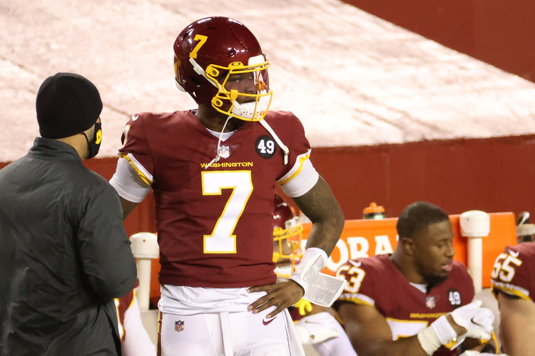 Dec 27, 2020; Landover, Maryland, USA; Washington Football Team quarterback Dwayne Haskins (7) stands on the sidelines after being benched against the Carolina Panthers in the fourth quarter at FedExField. Mandatory Credit: Geoff Burke-USA TODAY Sports