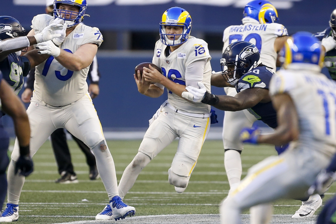 Dec 27, 2020; Seattle, Washington, USA; Seattle Seahawks defensive tackle Jarran Reed (90) sacks Los Angeles Rams quarterback Jared Goff (16) during the fourth quarter at Lumen Field. Mandatory Credit: Joe Nicholson-USA TODAY Sports