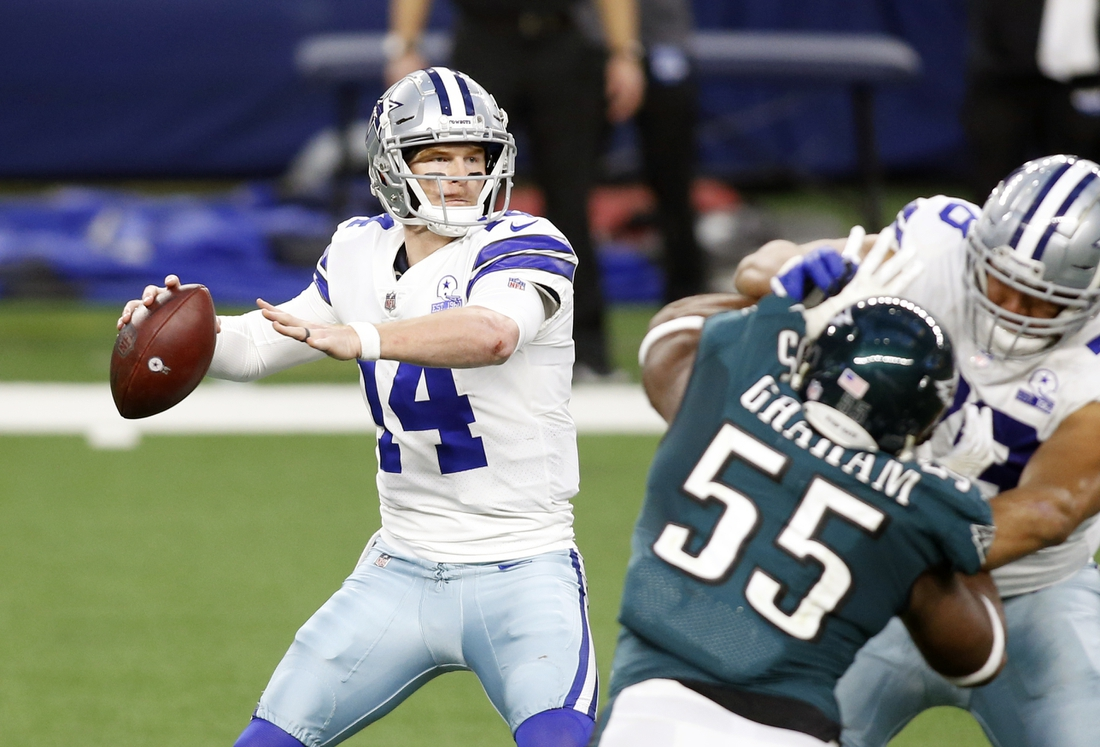 Dec 27, 2020; Arlington, Texas, USA; Dallas Cowboys quarterback Andy Dalton (14) throws a pass in the third quarter against the Philadelphia Eagles at AT&T Stadium. Mandatory Credit: Tim Heitman-USA TODAY Sports