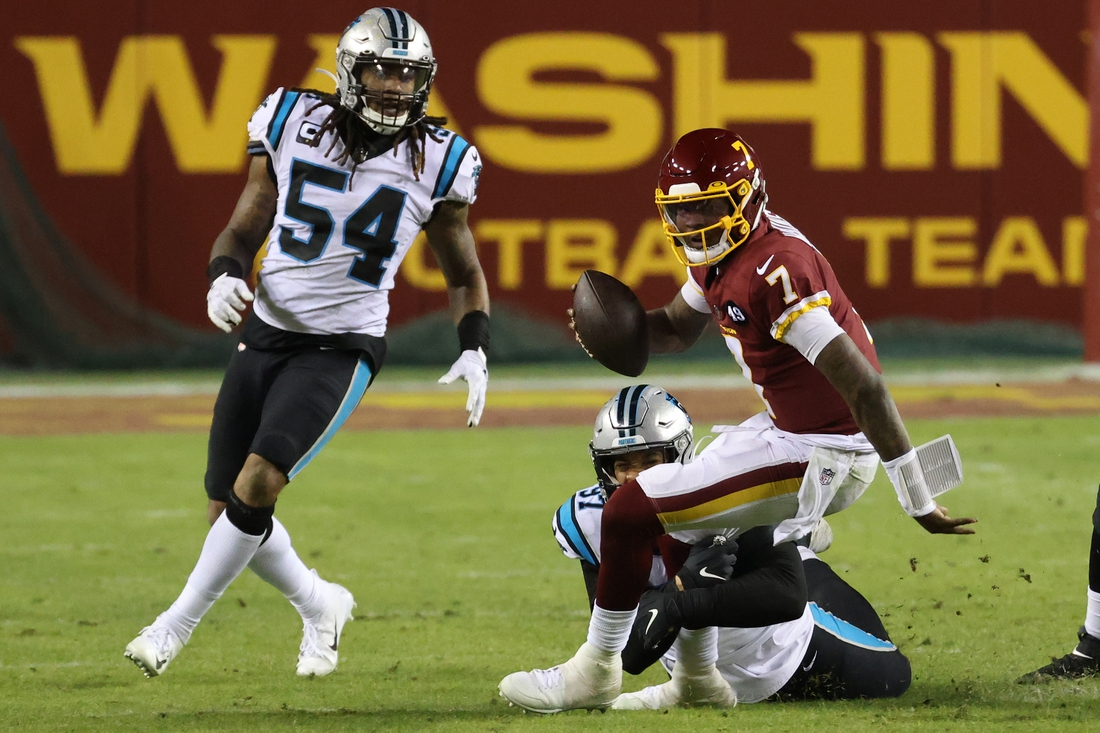 Dec 27, 2020; Landover, Maryland, USA; Washington Football Team quarterback Dwayne Haskins (7) is sacked by Carolina Panthers defensive end Yetur Gross-Matos (97) in the fourth quarter at FedExField. Mandatory Credit: Geoff Burke-USA TODAY Sports