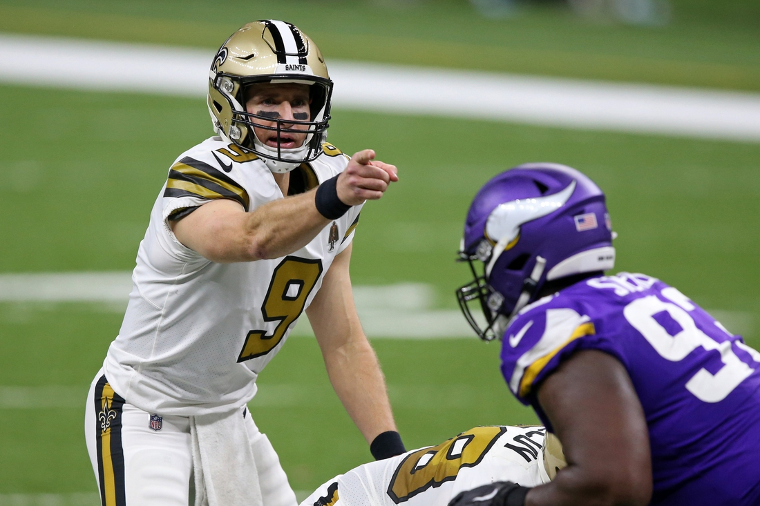 Dec 25, 2020; New Orleans, Louisiana, USA; New Orleans Saints quarterback Drew Brees (9) gestures in the second quarter against the Minnesota Vikings at the Mercedes-Benz Superdome. Mandatory Credit: Chuck Cook-USA TODAY Sports