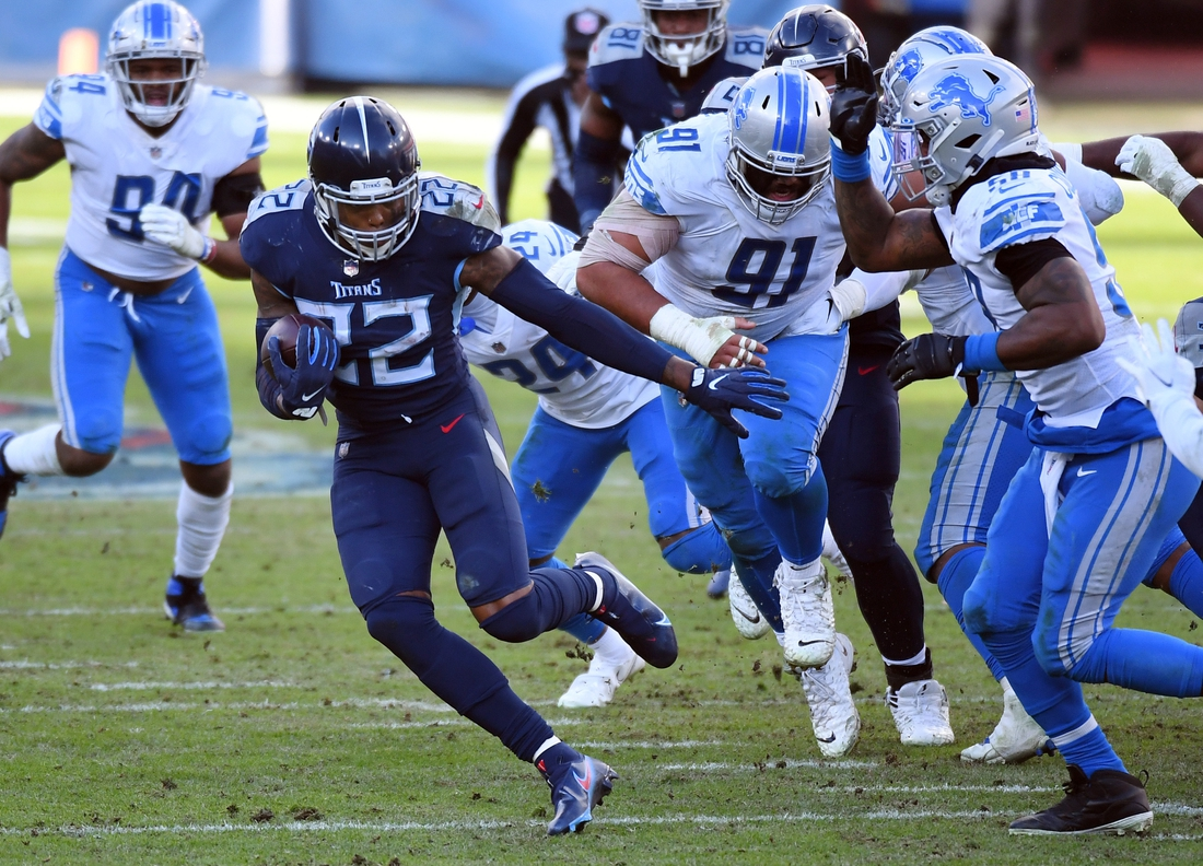Dec 20, 2020; Nashville, Tennessee, USA; Tennessee Titans running back Derrick Henry (22) runs for a first down during the second half against the Detroit Lions at Nissan Stadium. Mandatory Credit: Christopher Hanewinckel-USA TODAY Sports
