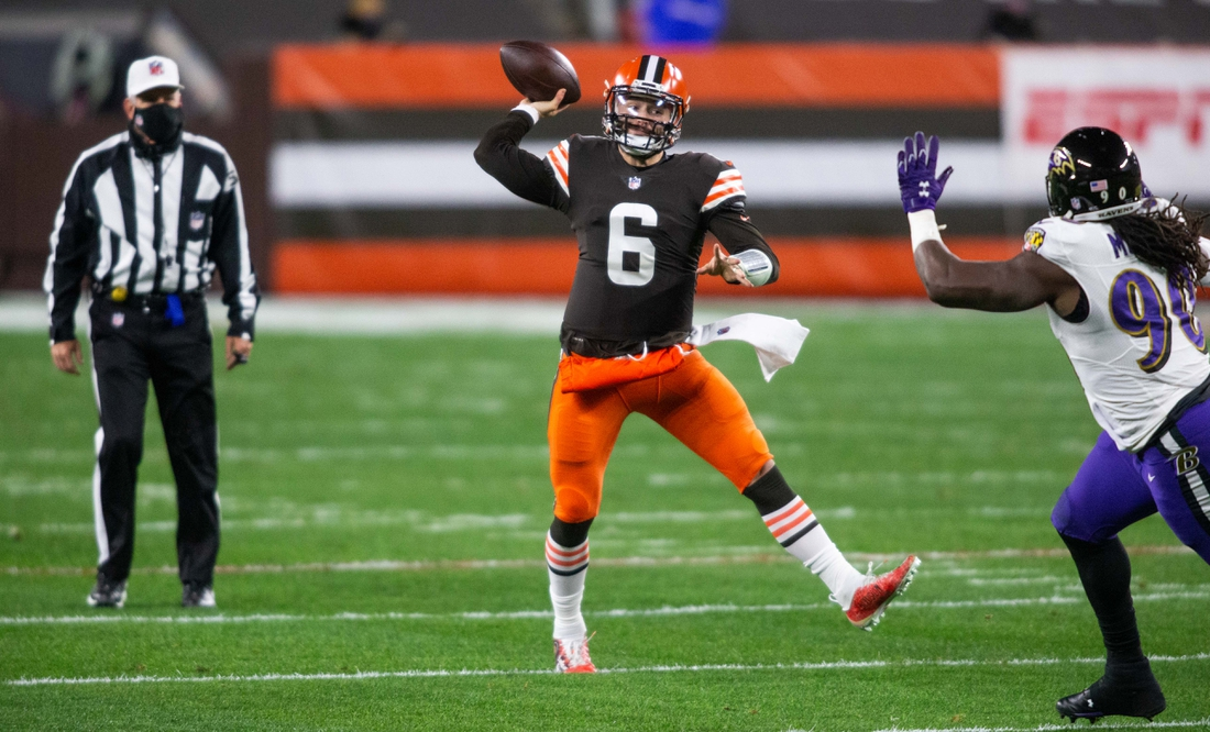 Dec 14, 2020; Cleveland, Ohio, USA; Cleveland Browns quarterback Baker Mayfield (6) throws the ball against Baltimore Ravens outside linebacker Pernell McPhee (90) during the first quarter at FirstEnergy Stadium. Mandatory Credit: Scott Galvin-USA TODAY Sports