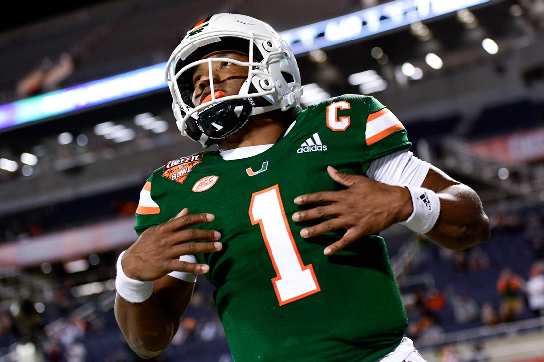 Dec 29, 2020; Orlando, FL, USA; Miami Hurricanes quarterback D'Eriq King (1) reacts after running the ball in for a touchdown which is called back for a penalty during the first half against the Oklahoma State Cowboys during the Cheez-It Bowl Game at Camping World Stadium. Mandatory Credit: Douglas DeFelice-USA TODAY Sports