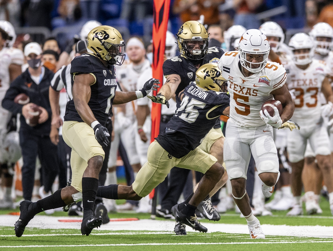 Dec 29, 2020; San Antonio, TX, USA; Texas Longhorns running back Bijan Robinson (5) tries to stay in bounds as he records a first down against the Colorado Buffaloes defense in the first quarter at the Valero Alamo Bowl at the Alamodome. Mandatory Credit: Ricardo B. Brazziell /American-Statesman-USA TODAY Sports