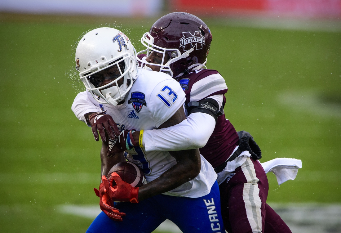 Dec 31, 2020; Fort Worth, TX, USA; Tulsa Golden Hurricane wide receiver Josh Johnson (13) is tackled by Mississippi State Bulldogs cornerback Emmanuel Forbes (13) during the first half at Amon G. Carter Stadium. Mandatory Credit: Jerome Miron-USA TODAY Sports