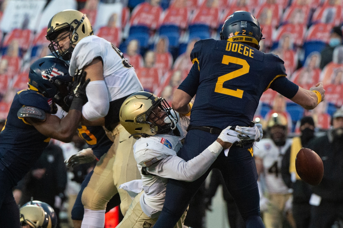 Dec 31, 2020; Memphis, TN, USA; Army Black Knights linebacker Arik Smith (53) sacks West Virginia Mountaineers quarterback Jarret Doege (2) for fumble during the first half  at Liberty Bowl Stadium. Mandatory Credit: Justin Ford-USA TODAY Sports