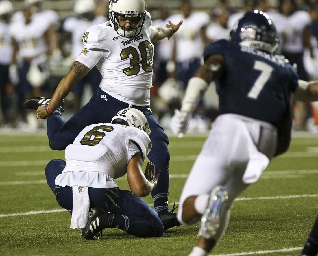 Sep 23, 2017; Houston, TX, USA; FIU Golden Panthers place kicker Jose Borregales (30) kicks a 37 yard field goal in the third quarter against the Rice Owls at Rice Stadium. Mandatory Credit: John Glaser-USA TODAY Sports