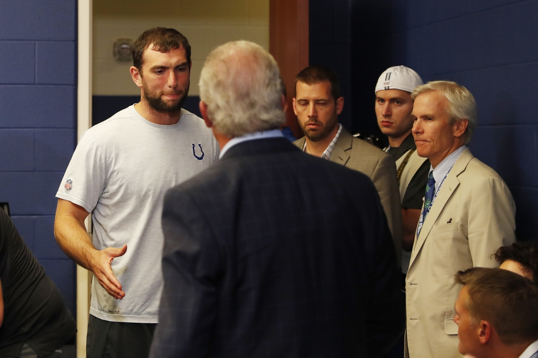Aug 24, 2019; Indianapolis, IN, USA; Indianapolis Colts quarterback Andrew Luck says goodbye to Colts owner Jim Irsay after announcing his retirement in a press conference after the game against the Chicago Bears at Lucas Oil Stadium. Mandatory Credit: Brian Spurlock-USA TODAY Sports