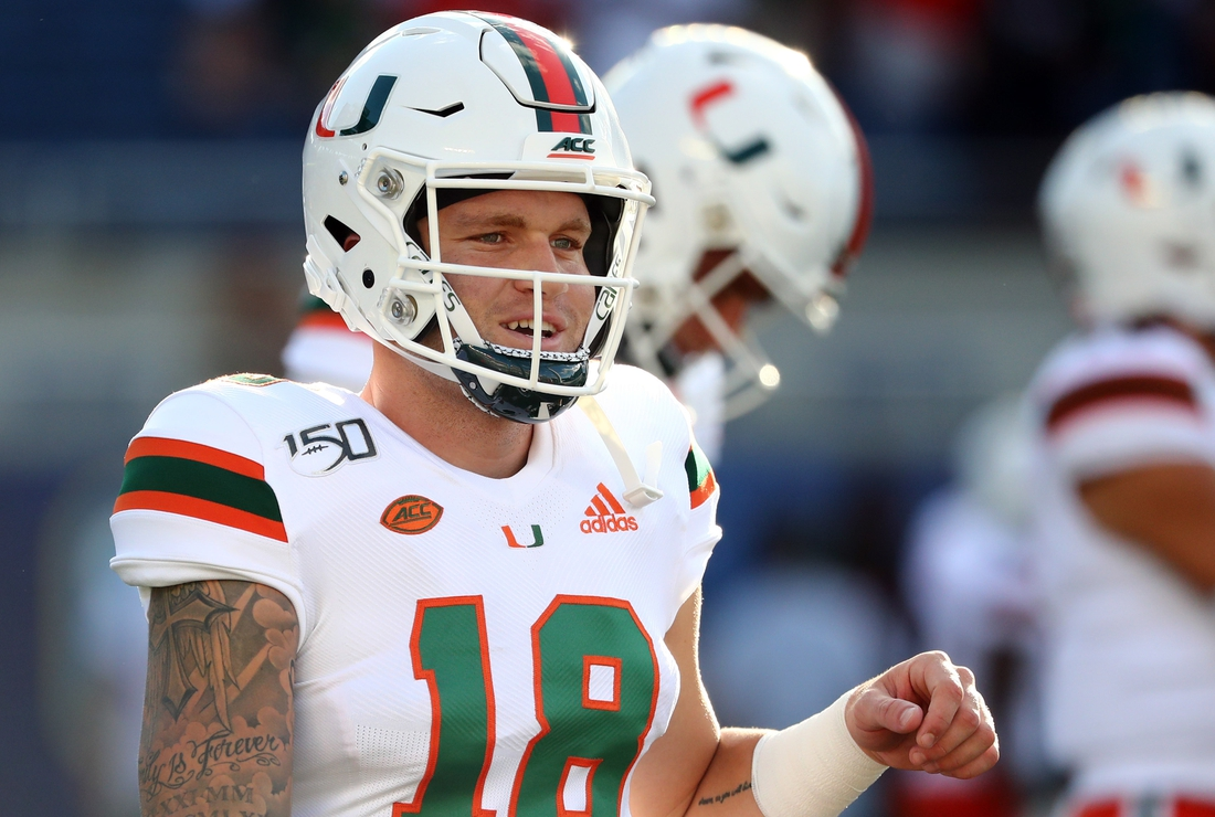 Aug 24, 2019; Orlando, FL, USA; Miami Hurricanes quarterback Tate Martell (18) works out prior to the game at Camping World Stadium. Mandatory Credit: Kim Klement-USA TODAY Sports