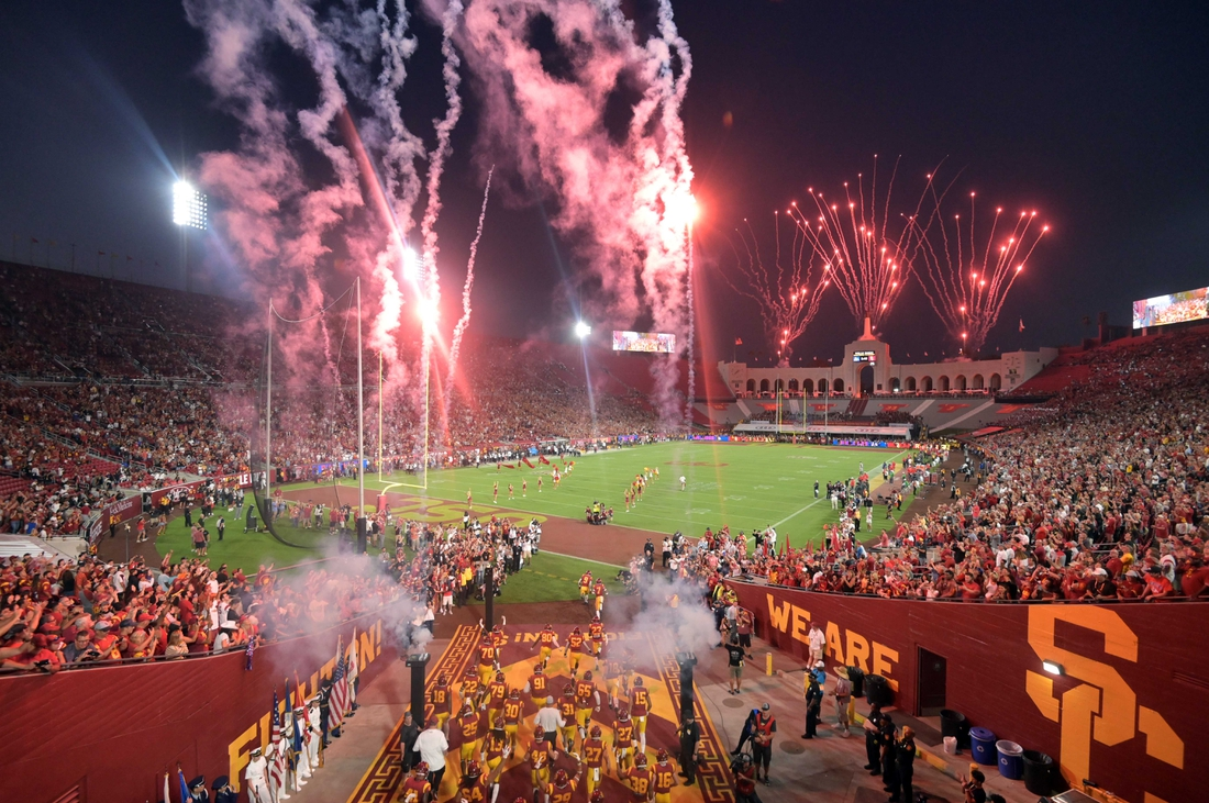 Aug 31, 2019; Los Angeles, CA, USA; General overall view as Southern California Trojans players run onto the field through pyrotechnics and fireworks before the game against the Fresno State Bulldogs at Los Angeles Memorial Coliseum. USC defeated Fresno State 31-23.  Mandatory Credit: Kirby Lee-USA TODAY Sports