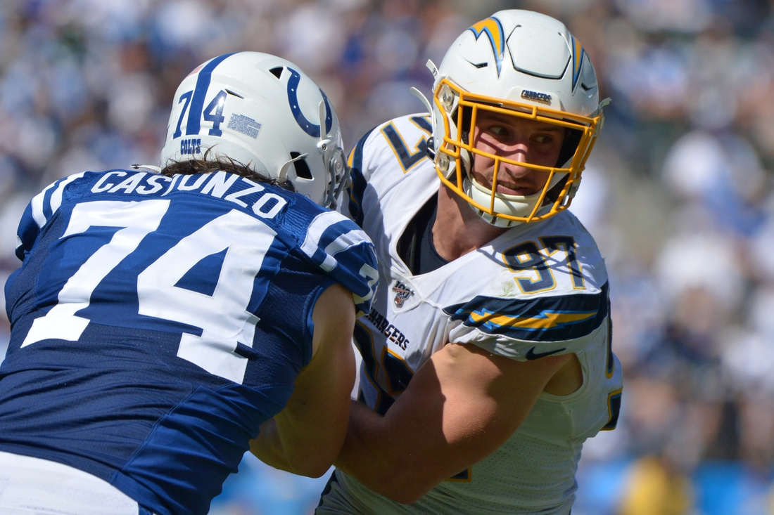 Sep 8, 2019; Carson, CA, USA; Los Angeles Chargers defensive end Joey Bosa (97) works against Indianapolis Colts offensive tackle Anthony Castonzo (74) during the third quarter at Dignity Health Sports Park. Mandatory Credit: Jake Roth-USA TODAY Sports