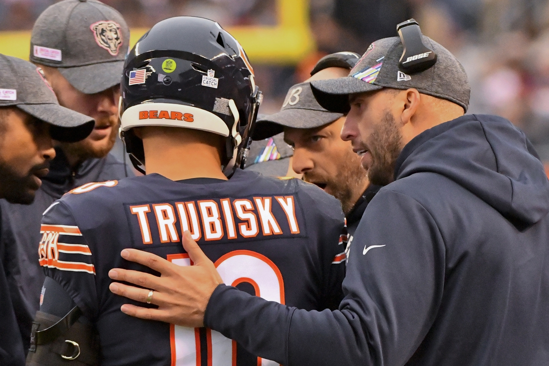 Oct 20, 2019; Chicago, IL, USA; Chicago Bears quarterback Mitchell Trubisky (10) talks with Chicago Bears head coach Matt Nagy, center, against the New Orleans Saints during the second half at Soldier Field. Mandatory Credit: Matt Marton-USA TODAY Sports