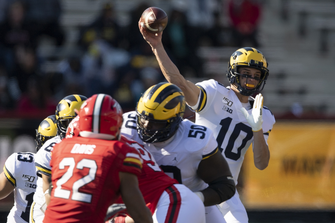 Nov 2, 2019; College Park, MD, USA;  Michigan Wolverines quarterback Dylan McCaffrey (10) throws during the fourth quarter against the Maryland Terrapins at Capital One Field at Maryland Stadium. Mandatory Credit: Tommy Gilligan-USA TODAY Sports