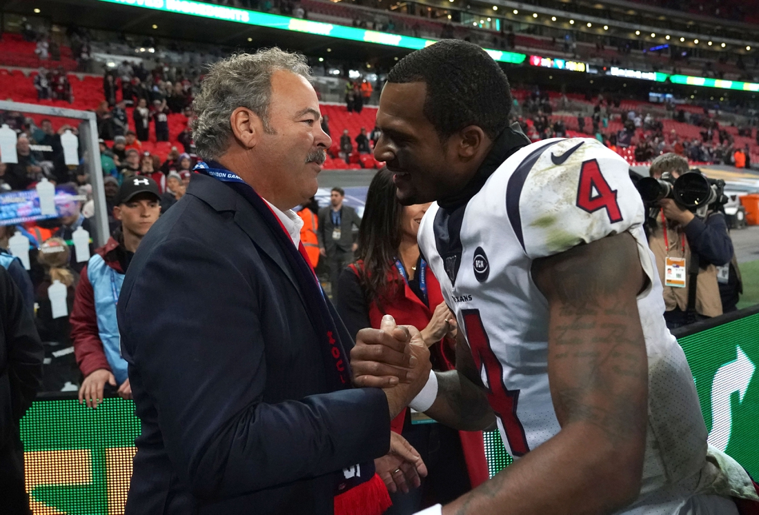 Nov 3, 2019; London, United Kingdom; Houston Texans chief executive officer D. Cal McNair shakes hands with quarterback Deshaun Watson (4) after an NFL International Series game against the Jacksonville Jaguars  at Wembley Stadium.  The Texans defeated the Jaguars 26-3. Mandatory Credit: Kirby Lee-USA TODAY Sports