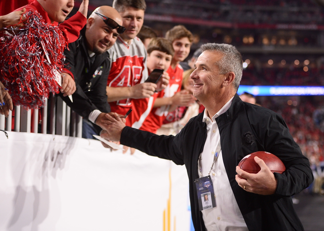 Dec 28, 2019; Glendale, AZ, USA; Ohio State Buckeyes former head coach Urban Meyer greets fans before the 2019 Fiesta Bowl college football playoff semifinal game against the Clemson Tigers at State Farm Stadium. Mandatory Credit: Joe Camporeale-USA TODAY Sports