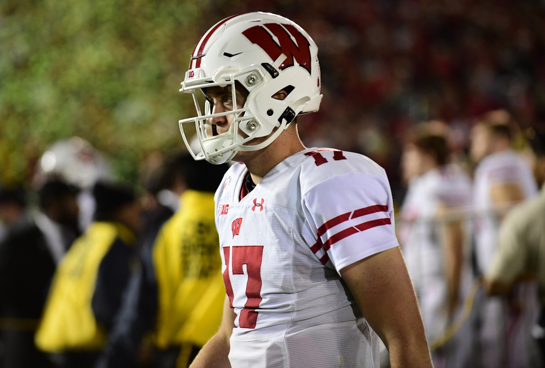 Jan 1, 2020; Pasadena, California, USA; Wisconsin Badgers quarterback Jack Coan (17) leaves the field after the 106th Rose Bowl game at Rose Bowl Stadium. The Oregon Ducks defeated the Wisconsin Badgers 28-27. Mandatory Credit: Gary A. Vasquez-USA TODAY Sports