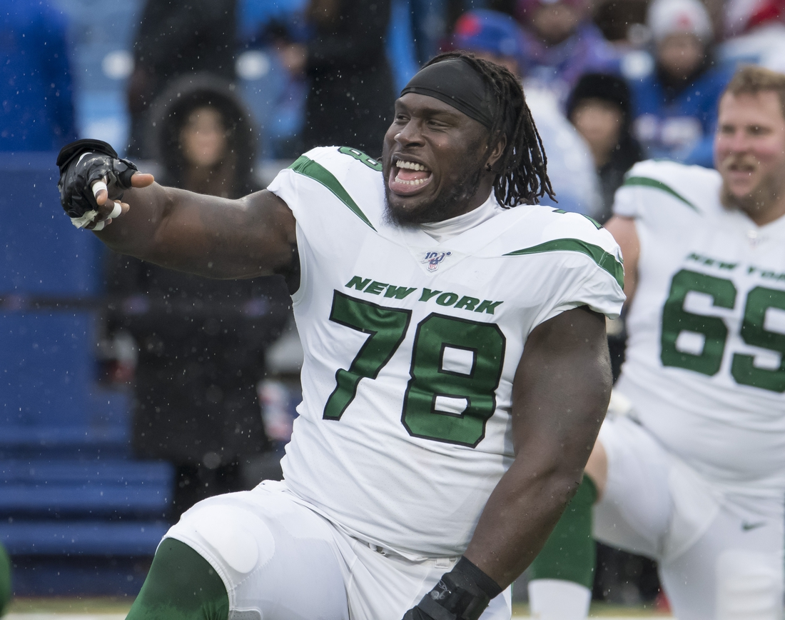 Dec 29, 2019; Orchard Park, New York, USA; New York Jets center Jonotthan Harrison (78) warms up prior to a game against the Buffalo Bills at New Era Field. Mandatory Credit: Mark Konezny-USA TODAY Sports