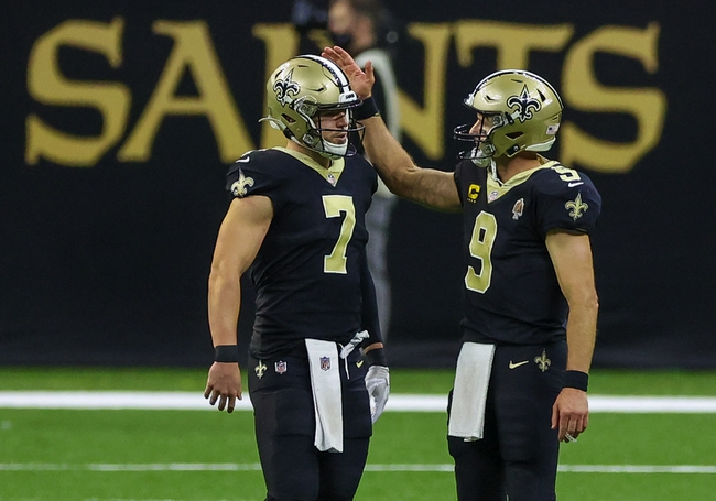 Sep 13, 2020; New Orleans, Louisiana, USA; New Orleans Saints quarterback Drew Brees (9) and quarterback Taysom Hill (7) during the fourth quarter against the Tampa Bay Buccaneers at the Mercedes-Benz Superdome. Mandatory Credit: Derick E. Hingle-USA TODAY Sports
