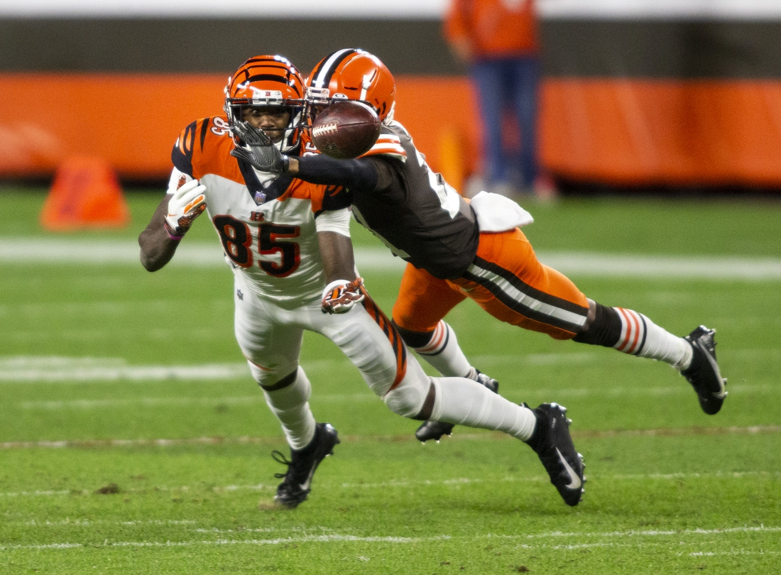 Sep 17, 2020; Cleveland, Ohio, USA; Cleveland Browns cornerback Denzel Ward (21) breaks up a pass intended for Cincinnati Bengals wide receiver Tee Higgins (85) during the fourth quarter at FirstEnergy Stadium. Mandatory Credit: Scott Galvin-USA TODAY Sports